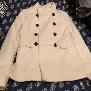 White/Cream colored winter coat with black buttons